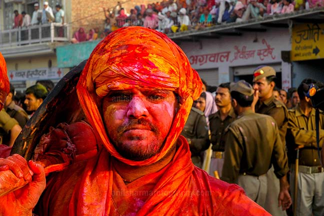 Festivals- Lathmaar Holi of Barsana (India) - A man daubed in color powder during Lathmaar Holi at Barsana, Mathura, Uttar Pradesh, India. by Anil