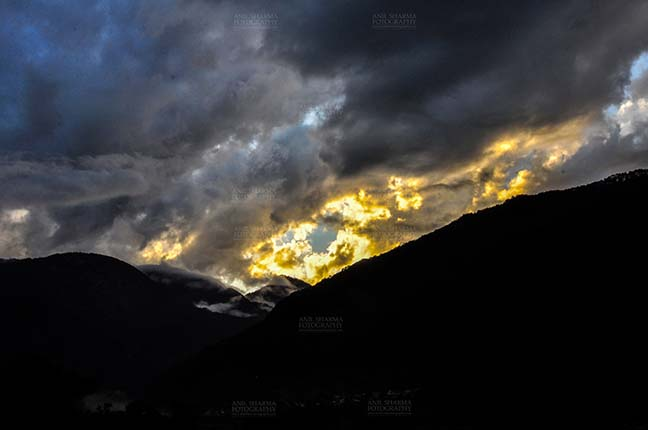 Clouds- Sky with Clouds (Uttarkashi) - Clouds over Uttarkashi Hills, Uttarakhand, India-  June 17, 2013: Dark sky in the evening with Yellow-black clouds over the hills of Uttarkashi, Uttarakhand, India. by Anil