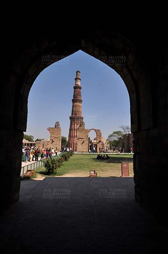 Monuments- Qutab Minar, New Delhi, India. - Qutub Minar the tallest brick minaret in the world seen through arch at Qutub Minar Complex, New Delhi, India. by Anil
