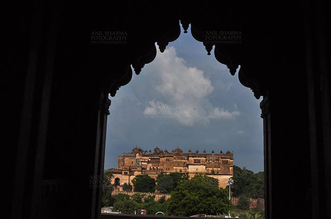 Monuments- Palaces and Temples of Orchha - Orchha, Madhya Pradesh, India- August 20, 2012: Jahangir Mahal, Citadel of Jahangir, viewed from Chaturbhuj Temple, Orchha, Madhya Pradesh, India. by Anil