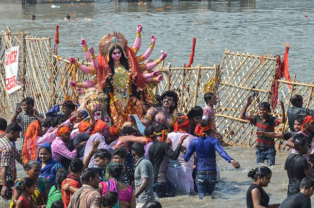 Festivals- Durga Puja Festival - Durga Puja Festival, New Delhi, India-September 30, 2017: The Idol of Goddess Durga before the final immersion into the river Yamuna at Kalindi Kunj, New Delhi, India. by Anil