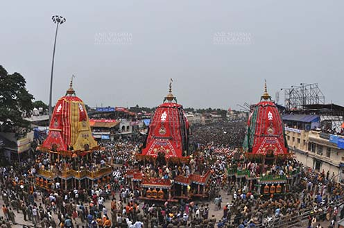 Festivals- Jagannath Rath Yatra (Odisha) - The chariots of Lord Jagannath, Balbhadra and Subhadra traditionally decorated, parked in front of the Jagannath temple at Puri, Odisha, India. by Anil