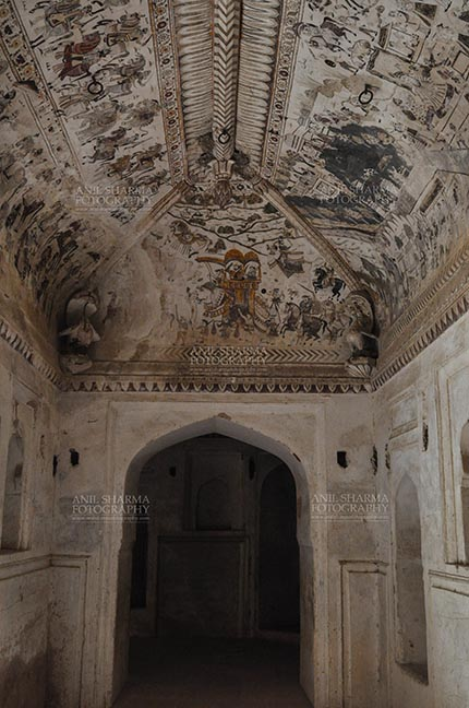 Monuments- Palaces and Temples of Orchha - Orchha, Madhya Pradesh, India- August 20, 2012: Mythological paintings on the ceiling, Lakshmi Narayan Temple, Orchha, Madhya Pradesh, India. by Anil