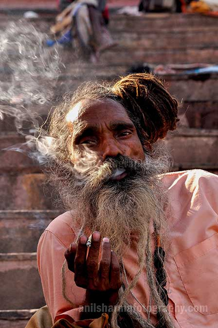 Culture- Naga Sadhu\u2019s (India) - A Naga Sadhu smoking  bidi at Varanasi ghat. by Anil