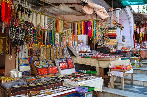 Fairs- Pushkar Fair (Rajasthan) - Pushkar, Rajasthan, India- May 23, 2008: Necklaces, beads, jewelry, gemstones, bracelets, earrings, bangles, and devotional object shop for religious ceremonies at Pushkar fair, Rajasthan, India. by Anil Sharma Fotography