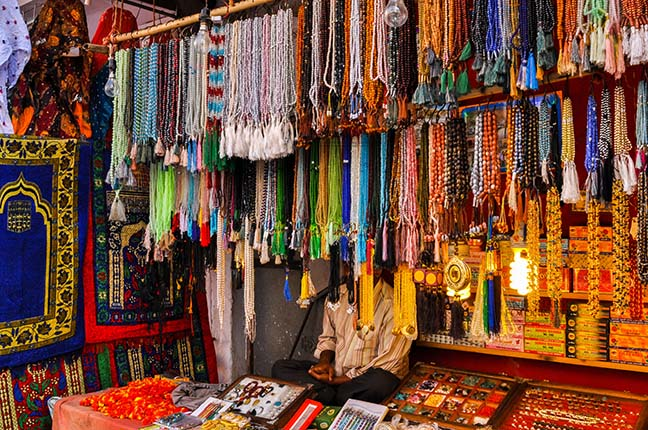 Religion- Dargah Sharif, Ajmer, Rajasthan (India) - Beads and stones being sold at shrine market place of Ajmer Sharif Dargah the Mausoleum of Moinuddin Chishti, a sufi saint from India at Ajmer, Rajasthan, India. by Anil