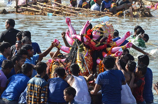 Festivals- Durga Puja Festival - Durga Puja Festival, New Delhi, India-September 30, 2017: Hindu devotees immersing idol of Goddess Durga in river Yamuna at Kalindi Kunj, New Delhi, India. by Anil Sharma Fotography