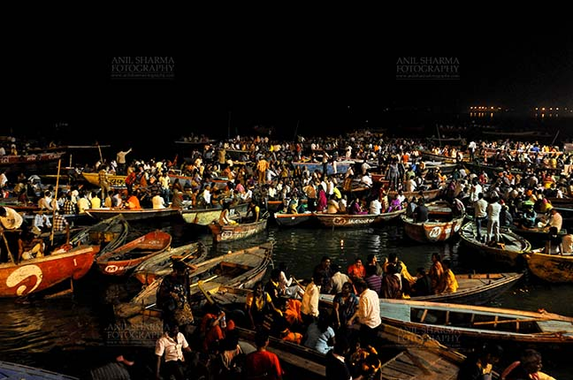 Travel- Varanasi the city of light (India) - Large number of devotees in boats admiring aarti at Dasashwamedh Ghats in late evening at Varanasi. Uttar Pradesh, India. by Anil
