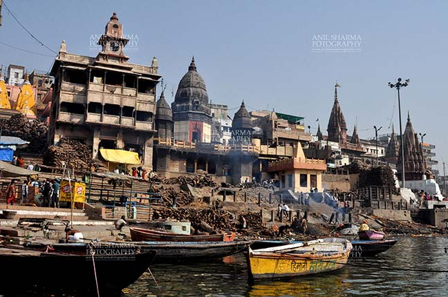 Travel- Varanasi the city of light (India) - The Manikarnika Ghats is the main Traditional Hindu cremation place where Hindu bodies are cremated at Varanasi, Uttar Pradesh, India. by Anil