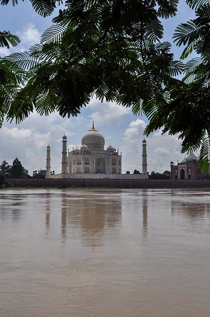 Monuments- Taj Mahal, Agra (India) - Taj Mahal in rainy season with flooded river Yamuna water all arround at Agra, Uttar Pradesh, India. by Anil