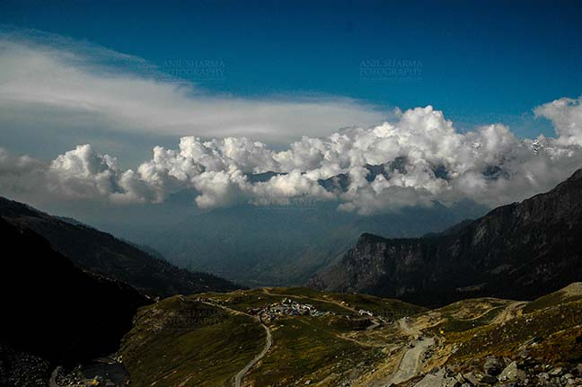 Clouds- Sky with Clouds (Rohtang La) - Clouds over Rohtan La, Himachal Pradesh, India-September 22, 2009: Snow covered mountain peaks with Dark blue sky and white clouds over Rohtang Pass, Himachal Pradesh, India. by Anil Sharma Fotography