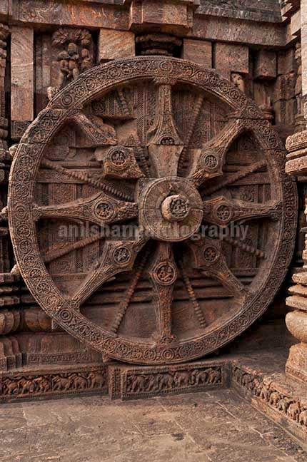 Monuments- Sun Temple Konark (Orissa) - One of the highly ornate carved wheels of Sun temple at Konark, Orissa, India. by Anil