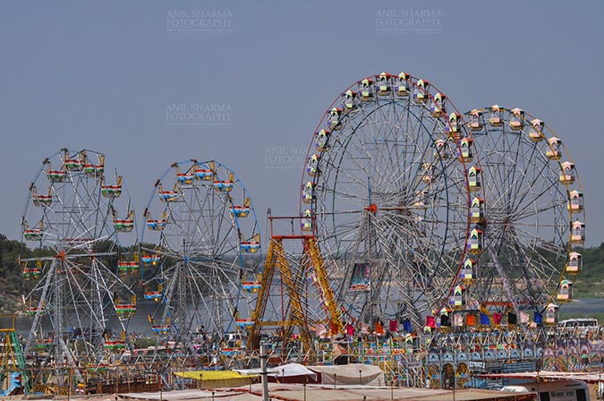 Fairs- Baneshwar Tribal Fair - Baneshwar, Dungarpur, Rajasthan, India- February 14, 2011: Joy ride on Ferris wheel is the other attraction for the tourists and devotees at Baneshwar, Dungarpur, Rajasthan, India. by Anil Sharma Fotography