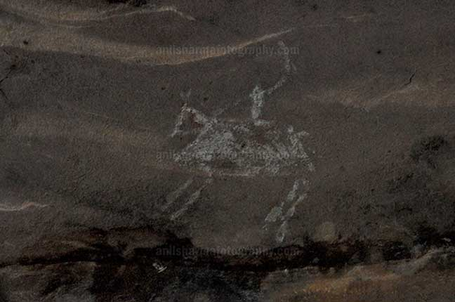 Archaeology- Bhimbetka Rock Shelters (India) - Prehistoric Rock Painting of a men riding a horse in white color at Bhimbetka archaeological site, Raisen, Madhya Pradesh, India by Anil Sharma Fotography