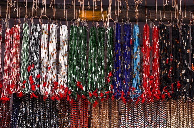 Fairs- Baneshwar Tribal Fair - Baneshwar, Dungarpur, Rajasthan, India- February 14, 2011: Necklaces, beads, jewelry, gemstones, bracelets, earrings, bangles shop at Baneshwar, Dungarpur, Rajasthan, India by Anil Sharma Fotography