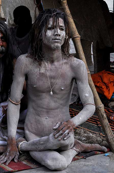 Culture- Naga Sadhu\u2019s (India) - A young Naga Sadhu in Yogic posture at Varanasi Ghat. by Anil