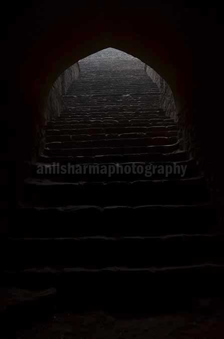 Monuments: Agrasen ki Baoli or Stepwell at New Delhi - The deepest section of the Agrasen ki Baoli at Hailey Road near Connaught Place, New Delhi, India by Anil