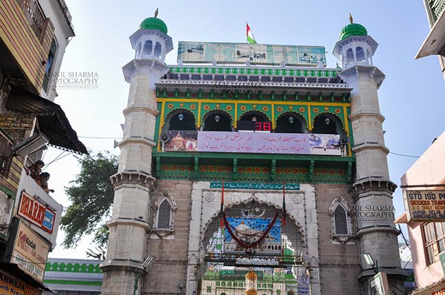 Religion- Dargah Sharif, Ajmer, Rajasthan (India) - Main entrance viewed from market, Ajmer Sharif Dargah the Mausoleum of Moinuddin Chishti, a sufi saint from India at Ajmer, Rajasthan, India. by Anil