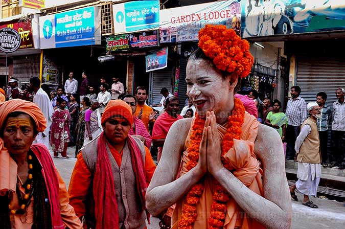 Culture- Naga Sadhu\u2019s (India) - A foreign Women Naga Sadhu greeting local people in Varanasi. by Anil Sharma Fotography