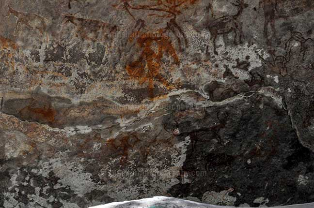 Archaeology- Bhimbetka Rock Shelters (India) - Prehistoric Rock Painting- a Hunter aiming at a deer at Bhimbetka archaeological site, Raisen, Madhya Pradesh, India by Anil Sharma Fotography