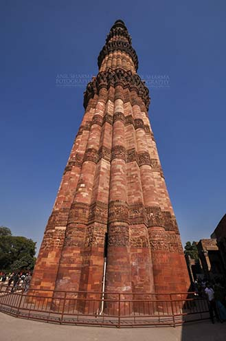 Monuments- Qutab Minar, New Delhi, India. - Qutab Minar with verses from Holy Quran, the Tallest brick Minaret at Qutab Minar Complex, New Delhi, India. by Anil