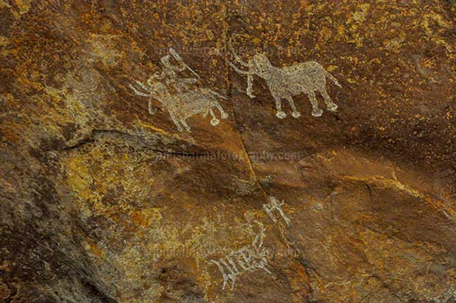 Archaeology- Bhimbetka Rock Shelters (India) - Prehistoric rock painting of men with two Elephants at Bhimbetka archaeological site Raisen, Madhya Pradesh, India by Anil