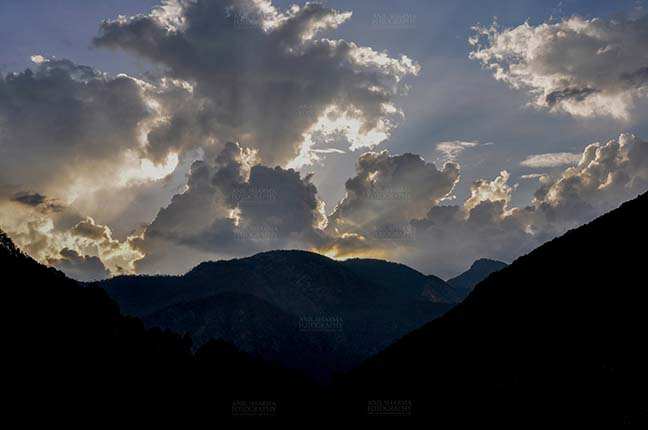 Clouds- Sky with Clouds (Harsil Valley) - Clouds, Harsil, Uttarakhand, India- June 12, 2013: After sunset, dark sky with clouds over the beautiful Harsil valley in the evening at Harsil, Uttarakhand, India. by Anil