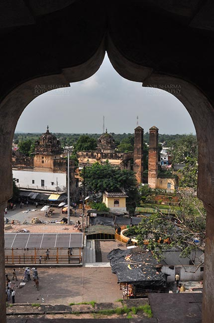 Monuments- Palaces and Temples of Orchha - Orchha, Madhya Pradesh, India- August 20, 2012: View from a carved window of Chaturbhuj temple, Orchha, Madhya Pradesh, India. by Anil