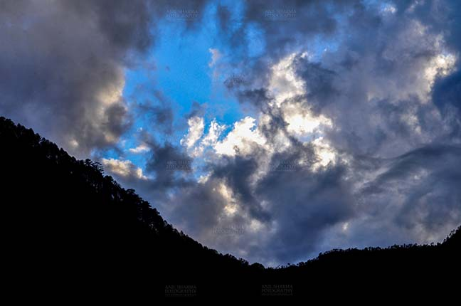 Clouds- Sky with Clouds (Uttarkashi) - Clouds over Uttarkashi Hills, Uttarakhand, India-  June 17, 2013: Blue sky in the evening with grey color  clouds over the hills of Uttarkashi, Uttarakhand, India. by Anil