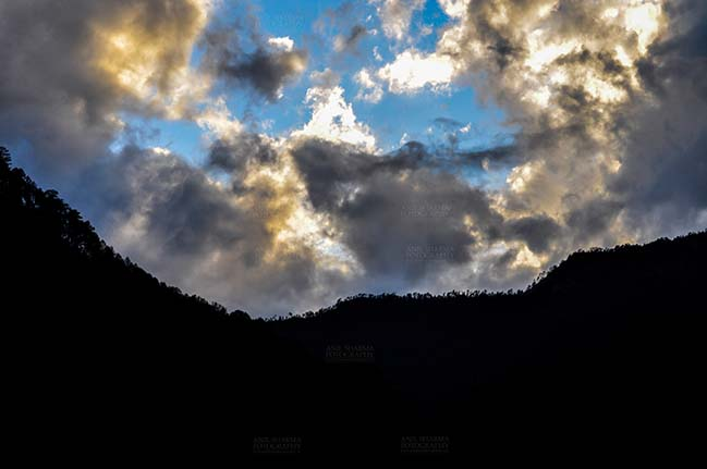 Clouds- Sky with Clouds (Uttarkashi) - Clouds over Uttarkashi Hills, Uttarakhand, India-  June 17, 2013: Blue sky in the evening with light yellow and grey clouds over the hills of Uttarkashi, Uttarakhand, India. by Anil