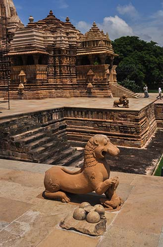 Monuments-  Khajuraho Temples (Madhya Pradesh) - Stone statue of a Lady playing with a Lion at Kandariya Mahadev Temple at Khajuraho, Madhya Pradesh, India. by Anil