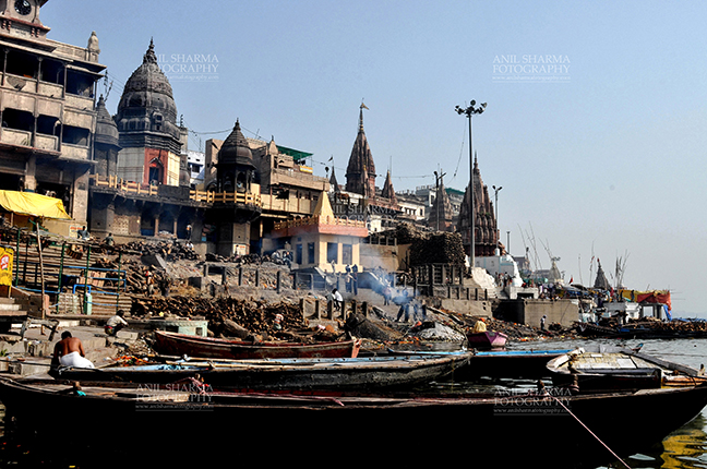 Travel- Varanasi the city of light (India) - The Manikarnika Ghats at the bank of Holy River Ganges is the main Traditional Hindu cremation place where Hindus bodies are cremated at Varanasi, Uttar Pradesh, India. by Anil