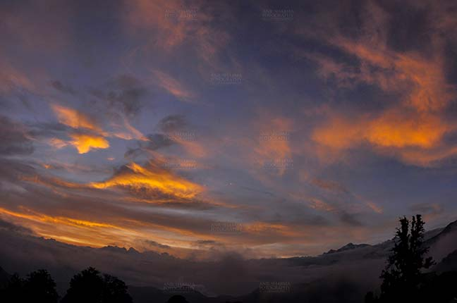 Clouds- Sky with Clouds (Tungnath) - Clouds, Chopta Tungnath, Uttarakhand, India- July 29, 2011: Blue sky with orange clouds in the evening at Chopta Tungnath, Uttarakhand, India. by Anil Sharma Fotography