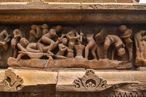 Monuments-  Khajuraho Temples (Madhya Pradesh) - Erotic representation, sculptural frieze, Khajuraho Group of monuments, UNESCO World Heritage Site, Madhya Pradesh, India. by Anil