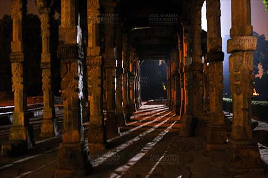 The Beauty of Hindu Columns with stone carving at Quwwat-Ul-Islam mosque courtyard in night at Qutub Minar Complex, New Delhi, India.