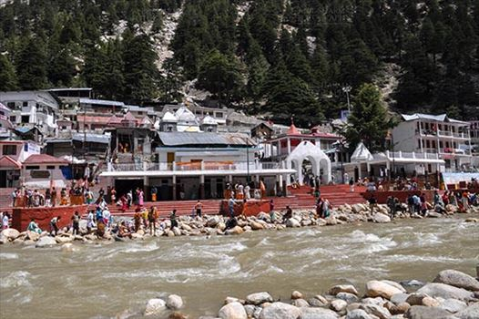 Gangotri, Uttarakhand, India- May 13, 2015: The Hindu devotees taking holy dip in ice cold water of Bhagirathi river at Gangotri, Uttarkashi, Uttarakhand, India.