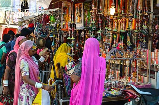 Pushkar, Rajasthan, India- January 16, 2018:  Rajasthani ladies shopping at shop during Pushkar Fair, Rajasthan, India.