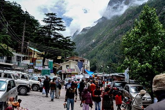 Gangotri, Uttarakhand, India- June 14, 2013: Devotees on their way to Goddess Ganga Temple at Gangotri, Uttarkashi, Uttarakhand, India.