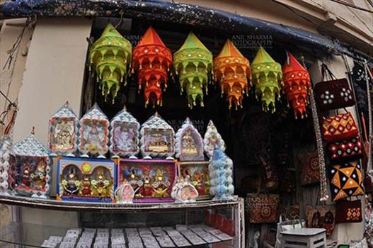 Festivals- Jagannath Rath Yatra (Odisha) - Mementos of Lord Jagannath, Balbhadra and Subhadra, handicrafts and chandeliers , on display at the shop near Lord Jagannath Temple at Puri, Odisha, India.