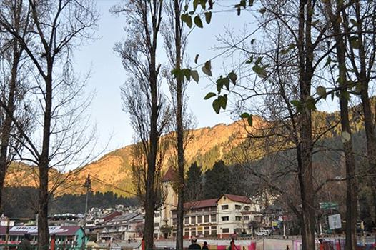 Travel- Nainital (Uttarakhand) - Nainital, Uttarakhand, India- November 11, 2015: View of Cheena peak and Nainital city from Boat House Club at Mallital, Nainital, Uttarakhand, India.
