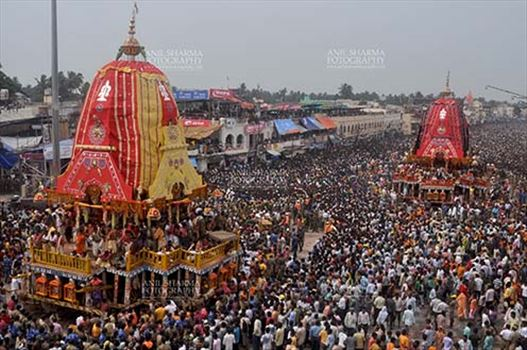 Festivals- Jagannath Rath Yatra (Odisha) - Procession of the glorious chariots of Lord Balbhadra and Lord Jagannath, accompanied by thousands of excited pilgrims, for Jagannath Rath Yatra festival at Puri, Odisha, India.