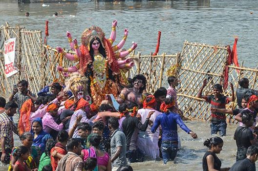 Durga Puja Festival, New Delhi, India-September 30, 2017: The Idol of Goddess Durga before the final immersion into the river Yamuna at Kalindi Kunj, New Delhi, India.