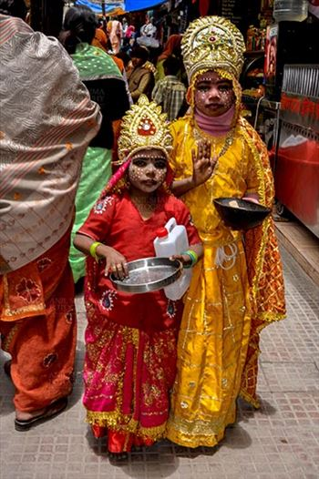 Gangotri, Uttarakhand, India- June 14, 2013: Two local kids dressed up as Goddess Ganga are bagging for alms in Gangotri, Uttarakhand, India.