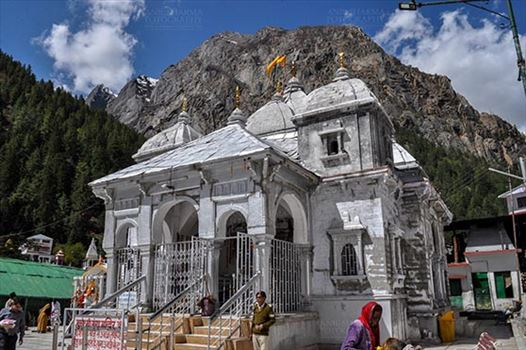 Gangotri, Uttarakhand, India- May 13, 2015: Goddess Ganges Temple with snow peaks and blue sky in the background at Gangotri, Uttarkashi, Uttarakhand, India.