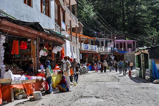 Gangotri, Uttarakhand, India- May 13, 2015: Main Bazaar of Gangotri, tourists buying devotional objects from the shops Gangotri, Uttarkashi, Uttarakhand, India.