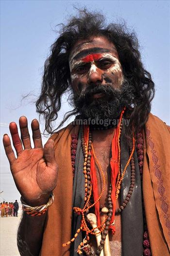 Culture- Aghori Sadhu, Uttar Pradesh (India). - Aghori Sadhu with long hairs, ash and tilak on face wearing human bones and  rudraksha bead at Mahakumbh mela, Allahabad, Uttar Pradesh, India.