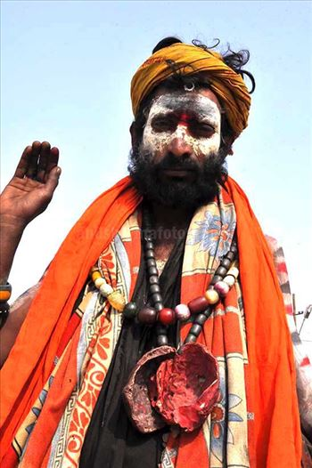 Culture- Aghori Sadhu, Uttar Pradesh (India). - Aghori Sadhu with ash on the face, wearing human bones and  rudraksha bead at Mahakumbh Allahabad, Uttar Pradesh (India).