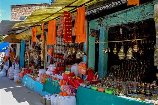 Gangotri, Uttarakhand, India- May 13, 2015: shopkeepers selling devotional objects, necklaces, beads, jewelry, gemstones, bracelets, earrings, bangles, and items for religious ceremonies at Gangotri, Uttarkashi, Uttarakhand, India.