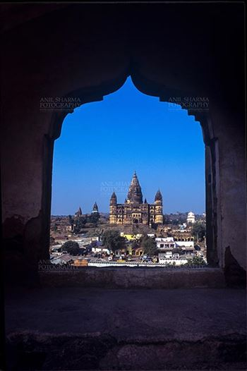 Orchha, Madhya Pradesh, India- May 14, 2008: View from a carved window of Jahangir Mahal, Chaturbhuj temple is seen in the distance, Orchha, Madhya Pradesh, India.