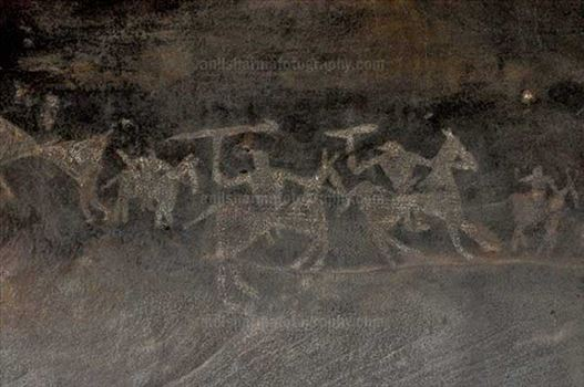 Archaeology- Bhimbetka Rock Shelters (India) - Prehistoric Rock Painting of Warriors on horses in the battle-field at Bhimbetka archaeological site, Raisen, Madhya Pradesh, India